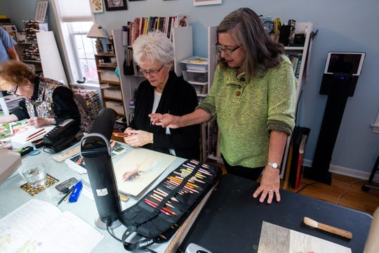 Valerie Hoste, right, works with Sandy Bouwens during a colored pencil painting class Thursday, Nov. 14, 2019, in Hoste's Port Huron studio.