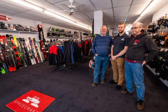 Brothers Kurt and Bob Eppley, co-founders of Alpine Cycles, pose for a photo with Kurt's son John Eppley, who serves as their general manager, in their new year-round ski shop Thursday, Nov. 14, 2019, in downtown Port Huron.