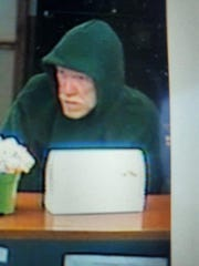 Surveillance video of bank robbery suspect