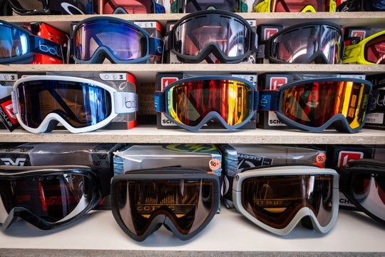 Goggles for skiing and snowboarding line shelves in Alpine Cycles' new year-round ski shop in downtown Port Huron.
