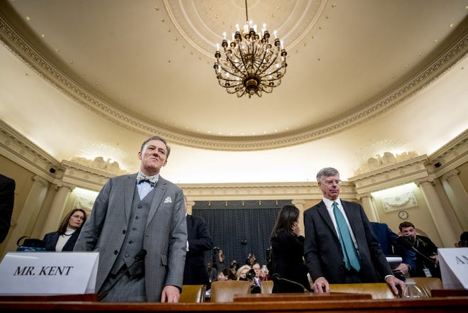 Career Foreign Service officer George Kent, left, and top U.S. diplomat in Ukraine William Taylor, right, return from a short break in testimony before the House Intelligence Committee on Capitol Hill in Washington, Wednesday, Nov. 13, 2019, during the first public impeachment hearing of President Donald Trump's efforts to tie U.S. aid for Ukraine to investigations of his political opponents. (AP Photo/Andrew Harnik)