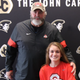 Scott Fitzkee is shown with his daughter, Bryn, as she signs her national letter of intent to play lacrosse for Ohio State.