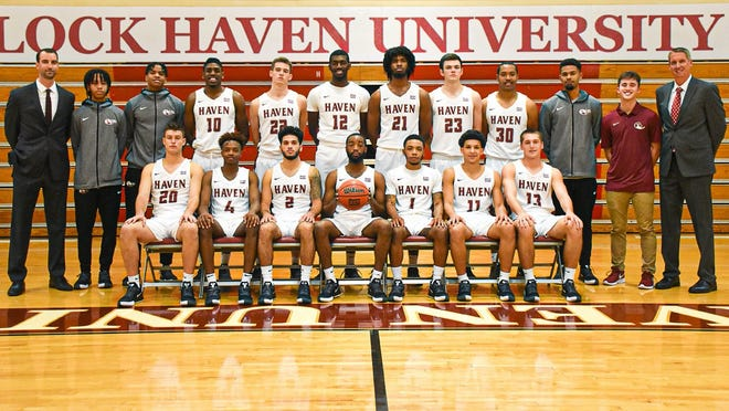 Brandon McGlynn, second from far right, transitioned from being a member of the Lock Have basketball team to the coaching staff after concussions ended his career.