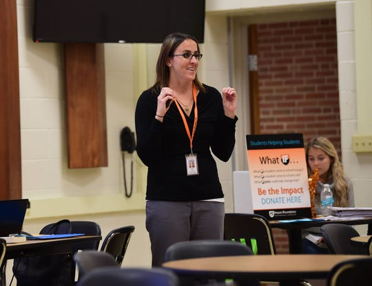 Miranda King, student and family services coordinator at York Suburban, talks with parents about mental health in sports and athletics at York Suburban Middle School on Wednesday, Nov. 13.