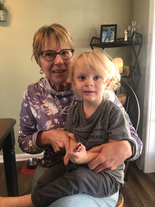 Chris Hanes (left) with her grandson, Ryland Harpster, almost 3 years old spend time together recently at Chris' new home.