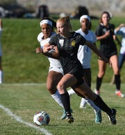 McQueen's Lena King, left, and Galena's Lauren Mugg chase down the ball during a match at Galena High School. Galena won, 1-0. Galena girls are the top seed for the girls state soccer tournament.