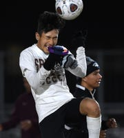 Sparks high's Marlon Monreal practices a head shot during practice on the Sparks high footbal field.