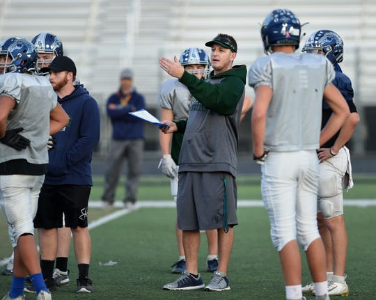 Damonte head coach Shawn Dupris gives instructions during practice for the regional playoffs on the Damonte Ranch football field.