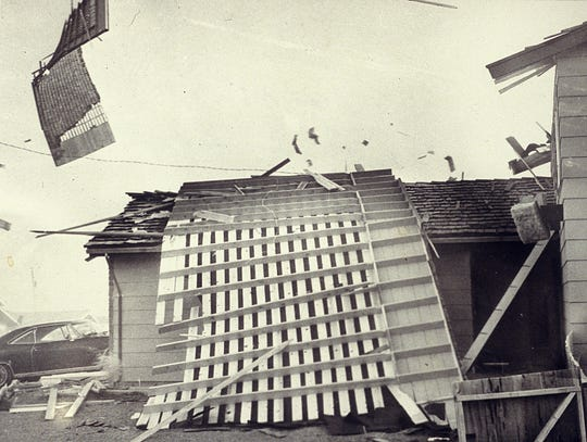 In the late 1970s, photographer Marilyn Newton captured this photo of a roof flying off the top of a home in Northwest Reno during a wind storm where winds reached up to 125 mph. She had to roll on the ground to get back to her car. Shortly after returning to her vehicle, a roof detached from a nearby house and fell on her car, totaling it. She continued to drive it despite the damage.