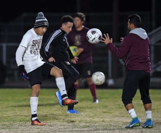 The Sparks high soccer team practices for the playoffs on the Sparks high footbal field.