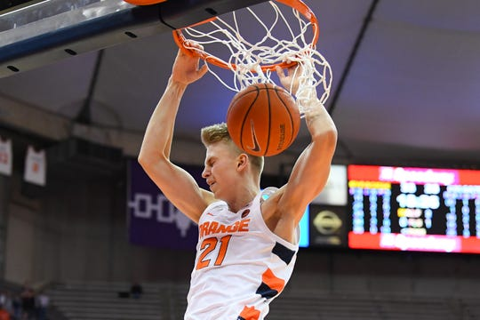Syracuse Orange forward Marek Dolezaj (21) dunks the ball against the Colgate Raiders during the second half at the Carrier Dome.