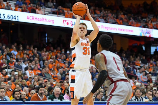 Syracuse Orange guard Buddy Boeheim (35) shoots the ball against the defense of Colgate Raiders guard Jordan Burns (1) during the second half at the Carrier Dome on Wednesday. Boeheim scored 17 points in Syracuse's 70-54 win.