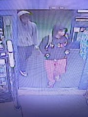 This is a screen shot of surveillance video taken of the two robbery suspects.