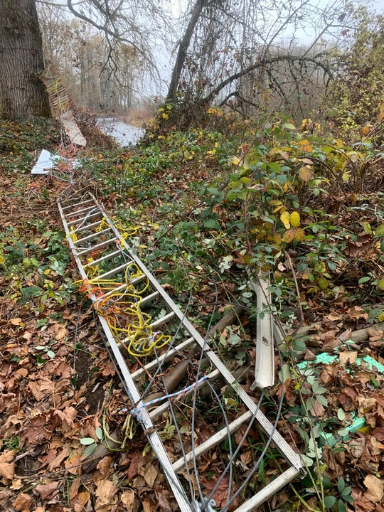 An illegal bridge that spanned across a river channel in the North Santiam River near Green's Bridge was removed by law enforcement officials on Wednesday, Nov. 14.