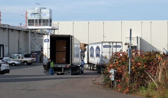 Trucks in front of the NORPAC Packing Plant #8 in Salem. Layoffs were announced at the plant Nov. 13.