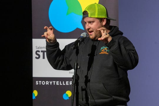 """Kris Brown tells a story about a turbulent hiking trip during the """"It Seemed Like A Good Idea At The Time"""" show for the Salem Storytellers Project at Salem's Historic Grand Theatre on Nov. 13."""