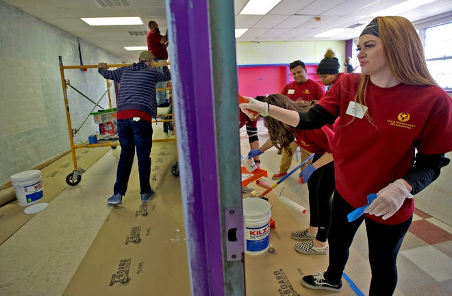 Brittany Bridges, right, paints a classroom at the Boys and Girls Club north side facility Thursday, Nov. 14, 2019.