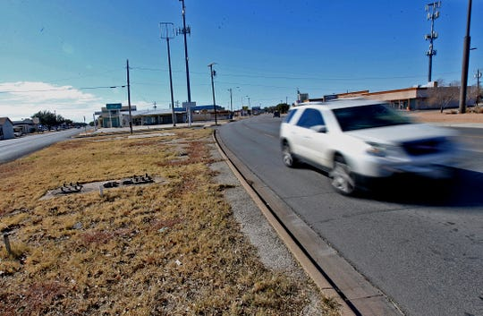 Traffic drives past a lot, seen in this Thursday, Nov. 13, 2019 photo at left, at the intersection of Sherwood Way and Beauregard Avenue that is scheduled for development.