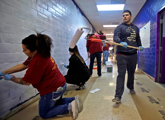 James Baker, right, prepares to help paint the hallway inside the Boys and Girls Club north side building on Thursday, Nov. 14, 2019.