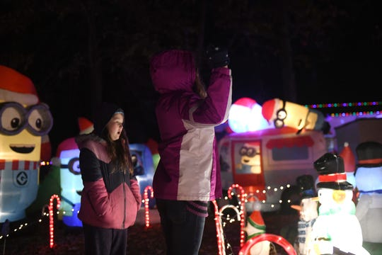 Hailey (right) and Paytlyn Davis, 11 and 9 respectively, take in the sights of their uncle Curtis' display in Pittsville, Maryland, on Nov. 13, 2019.