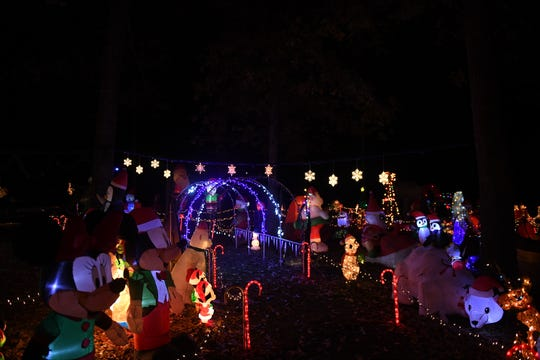 A holiday light and figurine display covers the yard of Curtis Davis, 39, in Pittsville, Maryland, on Nov. 13, 2019. This is the second year of his mega display, and the Pittsville native wants to continue the tradition for years to come.