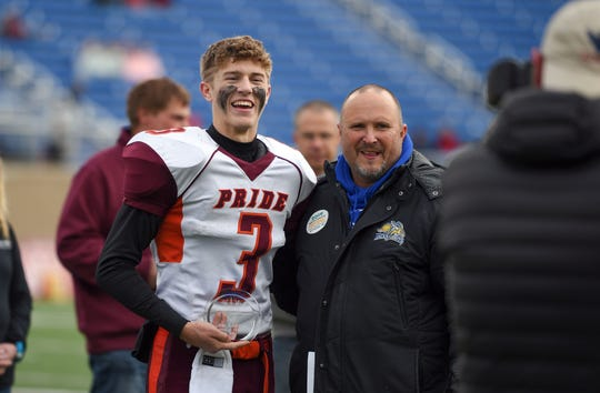 Trey Ortman of Canistota-Freeman smiles after winning two awards following the Class 9A state football finals on Thursday, Nov. 14, at the Dana J. Dykehouse Stadium in Brookings.