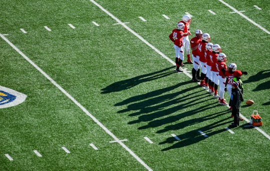 Britton-Hecla players line up during warm-ups before the Class 9A state football finals on Thursday, Nov. 14, at the Dana J. Dykehouse Stadium in Brookings.