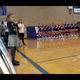 Eden Barkmeier sings the national anthem at a volleyball game in Warner.