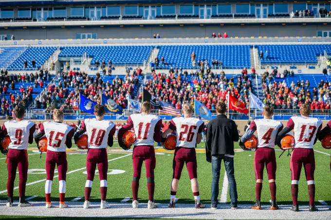 The Canistota-Freeman Pride stand for the national anthem before the Class 9A state football finals on Thursday, Nov. 14, at the Dana J. Dykehouse Stadium in Brookings.