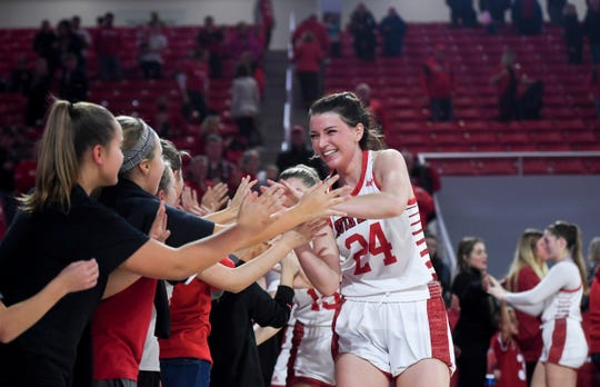 USD's Ciara Duffy (24) high-fives fans after a USD win against Drake on Wednesday, Nov. 13,  2019 at Sanford Coyote Sports Center in Vermillion. The final score of the game was 102-94.