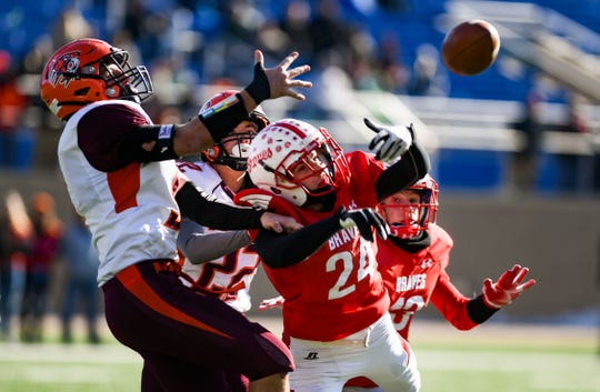 Canistota-Freeman and Britton-Hecla players fight for control of the ball during the Class 9A state football finals on Thursday, Nov. 14, at the Dana J. Dykehouse Stadium in Brookings.