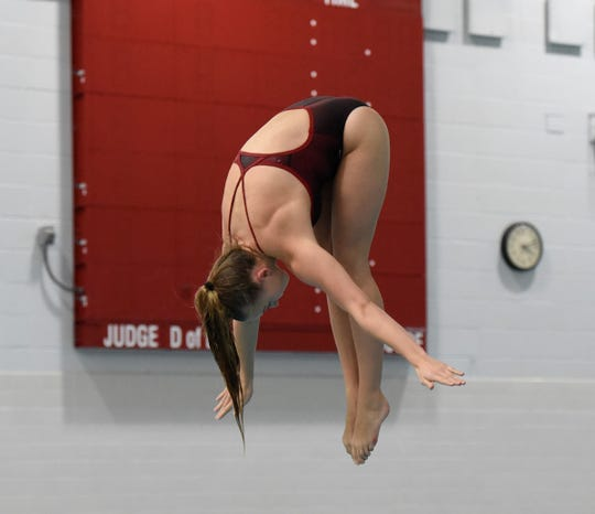 ROCORI senior Olivia Motter practices a dive Wednesday, Nov. 13, 2019, at ROCORI High School.