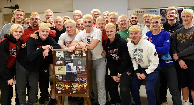 ROCORI football players smile for a photo with their recently bleached mullets Wednesday, Nov. 13, 2019, at ROCORI High School.
