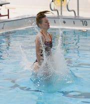 ROCORI senior Maggie Headlee enters the water during a dive attempt Wednesday, Nov. 13, 2019, at ROCORI High School.