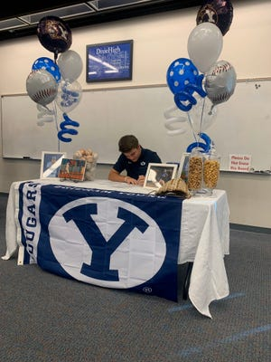 Dixie High's Cooper Vest signs his letter of intent to play baseball for the BYU Cougars on Nov. 13, 2019.