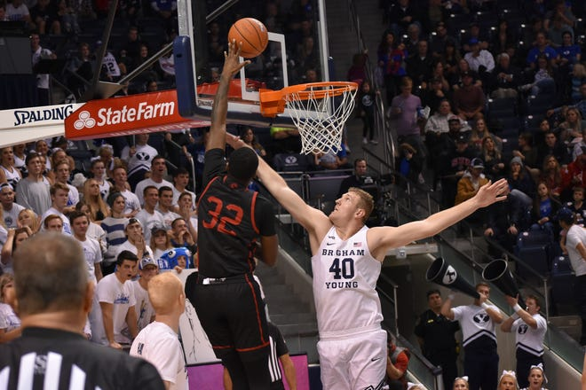 SUU's Andre Adams goes up for a shot over BYU's Kolby Lee.