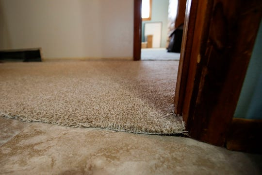 Loose carpet is seen in Pam Betro's home on Thursday, November 14, 2019, at 3230 Jackson Avenue in Plover, Wis. Ray Marchel was contracted for various home repairs, and faces charges for theft in Marathon, Lincoln and Portage Counties.