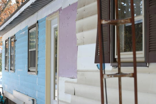 Partially-removed siding is seen on an exterior wall of Pam Betro's home on Thursday, November 14, 2019, at 3230 Jackson Avenue in Plover, Wis. Ray Marchel was contracted for various home repairs, and faces charges for theft in Marathon, Lincoln and Portage Counties.