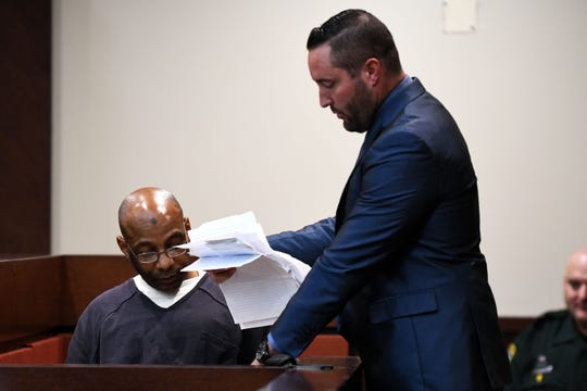 Henry Segura's defense attorney Nate Prince presents James Carlos Santos, the man who said he ordered the murders of Brandi Peters from federal prison to settle a drug debt she owed, with a stack of letters he wrote to Peters.