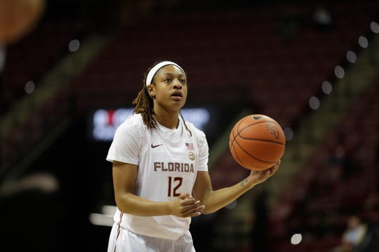 Florida State Seminoles guard Nicki Ekhomu (12) shoots a free throw during a game between the FSU Seminoles and the Jacksonville Dolphins Wednesday, Nov. 13, 2019.