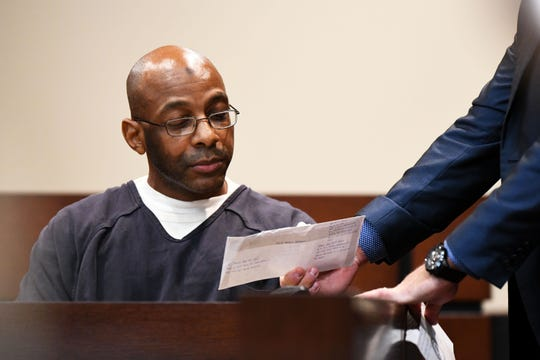 Henry Segura's defense attorney Nate Prince shows James Carlos Santos, the man who said he ordered the murders of Brandi Peters from federal prison to settle a drug debt she owed, a envelope that he addressed to Peters.