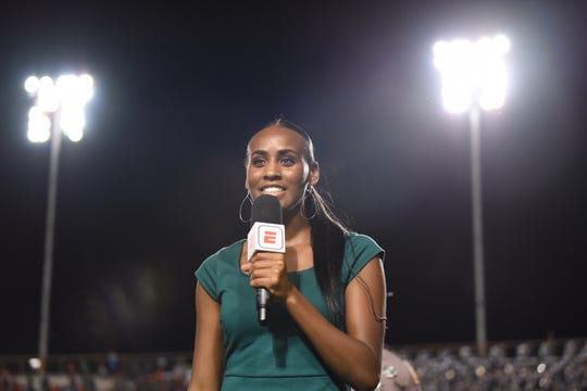 FAMU women's basketball guard/forward Corey Staples serves as a student sideline reporter covering Rattler football home games for the ESPN3 live stream. She gives commentary for the game versus Southern on Sept. 21.