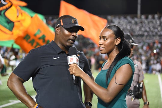 FAMU women's basketball guard/forward Corey Staples interviews football head coach Willie Simmons during the game versus Southern on Sept. 21 as a sideline reporter for the ESPN3 live stream.