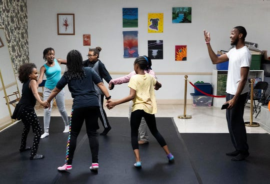 """I've been coming for a couple of weeks and think this place is great. I just love to dance and here, I learn a lot,"" said Milan Taylor, 8, far left, of Fort Pierce, who takes a hip-hop class from Michael Matthews, right, during the after-school arts program at the Lindsay School of the Arts on Wednesday, Nov. 13, 2019, in Fort Pierce. The school is planning a $4 million restoration of the former St. Anastasia Catholic School. Cindy Bridges, the owner of the Lindsay School of the Arts, won the bid from the city of Fort Pierce to restore the 105-year old building. The Lindsay School of the Arts is a free, 2-year old, after-school program for students in St. Lucie County. It is funded through donations and the Children's Services Council of St. Lucie County. Currently, the Lindsay School operates out of the Crane House, a half a block west of St. Anastasia Catholic School. It teaches students drama, creative writing, painting, dance, piano and drums."