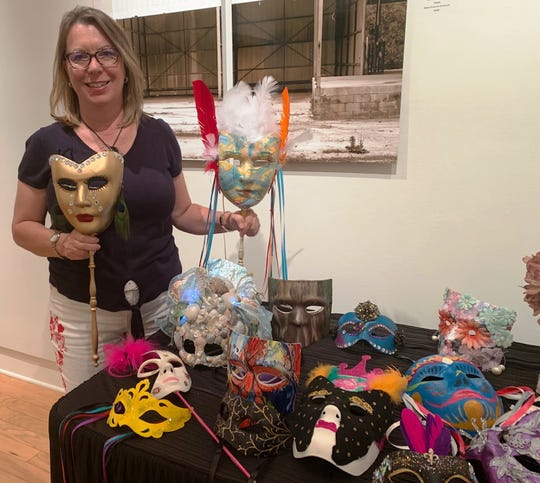 Nancy Turrell, CEO of the Arts Foundation for Martin County, with a small sampling of the masks that are on sale at Court House Cultural Center in Stuart.