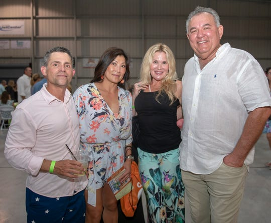 Robert and Jeanie Ladd, left, with Lora and Bill Brothers at the Big Taste of Martin County for Big Brothers Big Sisters onOct.15, 2019, at the Stuart Jet Center.