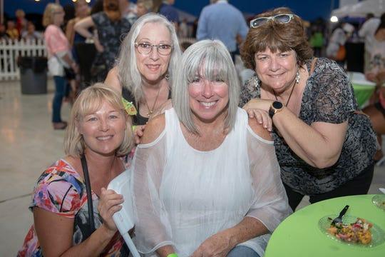 Lisa Barrett, left, Dottie Falvi, Shaun Kelly and Joan Pittman at the Big Taste of Martin County for Big Brothers Big Sisters onOct.15, 2019, at the Stuart Jet Center.