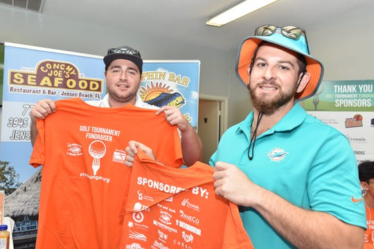 Mason Cremasco, left, and Gaby Ghazal played in the Dolphin Bar & Shrimp House Golf Tournament Fundraiser for Treasure Coast Food Bank.