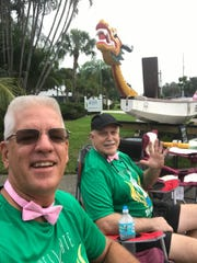 The Hell Gate Sea Dragons' boat was on display at the 2019 Making Strides Against Breast Cancer Walk in Stuart. Pictured are Jim St. Pierre, left, and Bob Wolfort, supporters of the Hell Gate Sea Dragons.