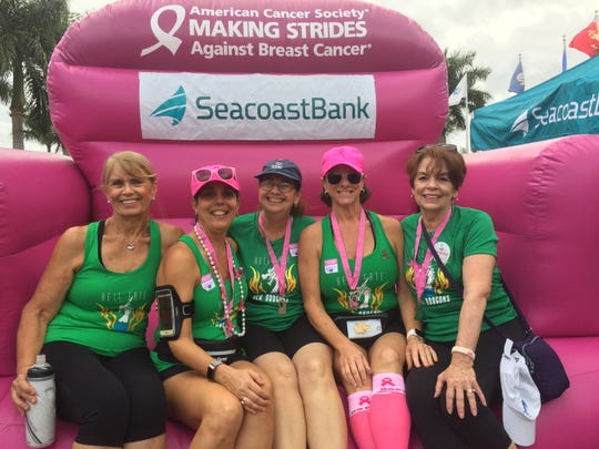 Hell Gate Sea Dragons members Martha Schanel, left, Shelley Polk, Diane Wolfort, Debbie Diamond and Peggy Horvath volunteer at the Making Strides Against Breast Cancer Walk in Stuart on Oct. 26, 2019.